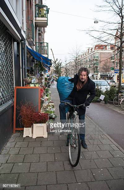 Man about to transport a christmas tree