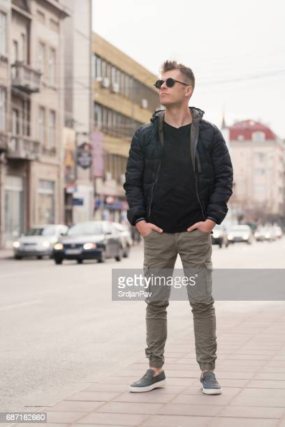 man about town - cargo pants stock photos and pictures