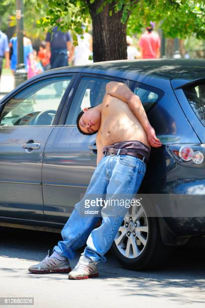 man accidentally falling asleep. standing. - chile stock pictures, royalty-free photos & images