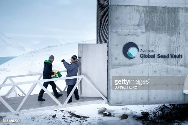 A man acrries one of the newly arrived boxes containing seeds from Japan and USA into the international gene bank Svalbard Global Seed Vault outside...