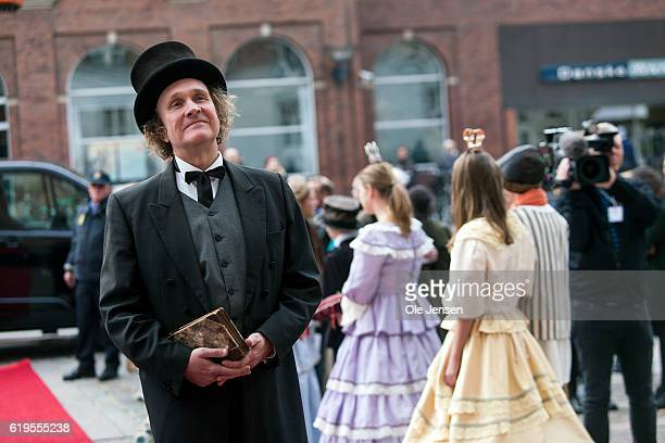 A man acting as the Danish fairy tale author Hans Christian Andersen prior to arrival of Crown Princess Mary and Japanese author Haruki Murakami who...