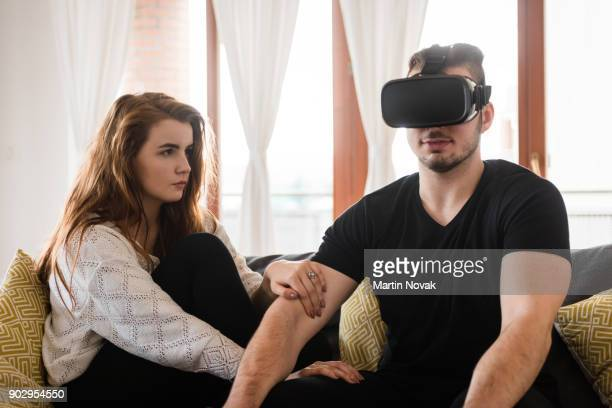 Man addicted to vr technology, wearing headset gear.