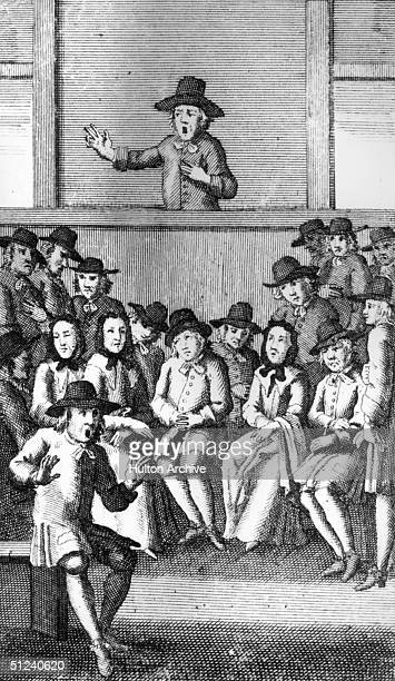 Man addresses a meeting of the Quakers, or Religious Society of Friends. Original Artwork: An illustration from Tom Brown's 'Works', published in...