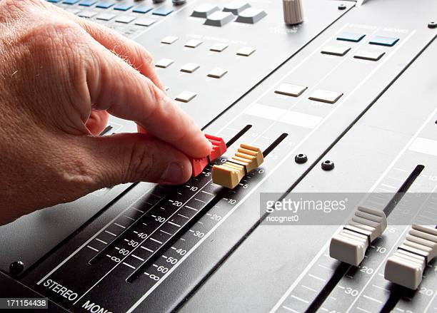 Man adjusting a mixing board