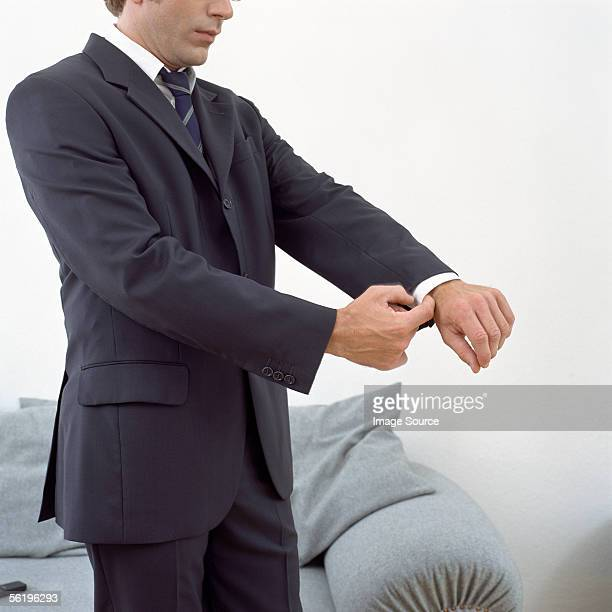 man adjusting his cuffs - giacca da abito foto e immagini stock