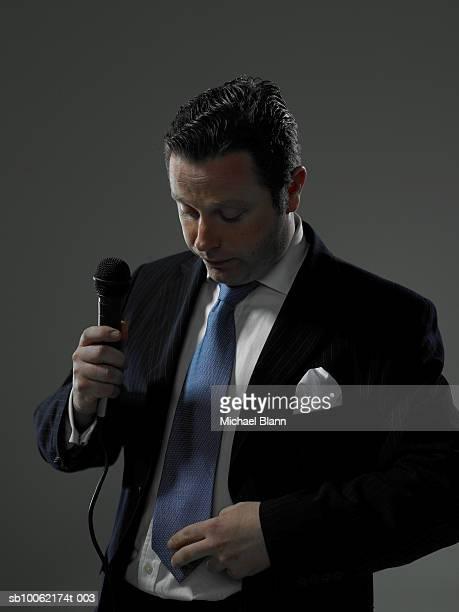 Man adjusting microphone