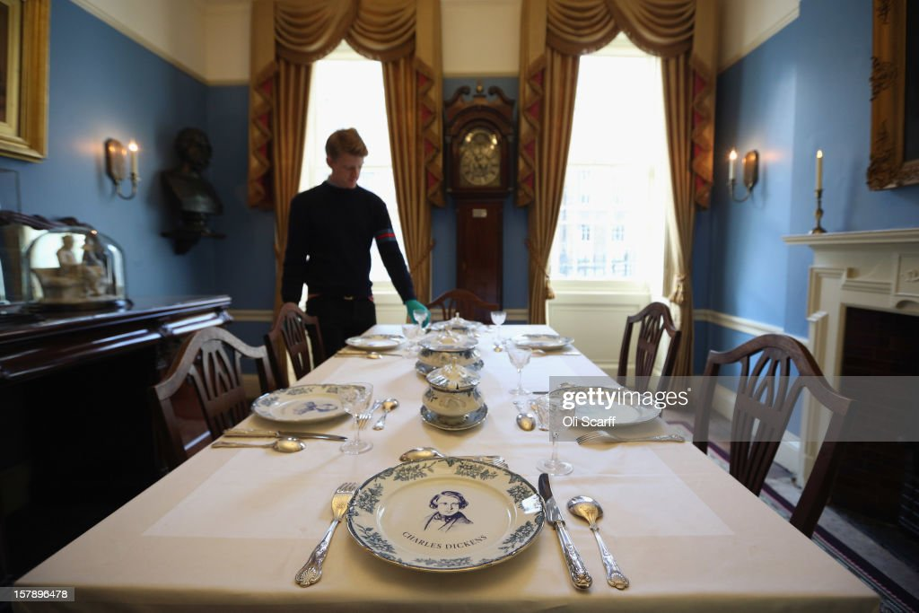 A Man Adjusts The Cutlery In Dining Room Inside Charles Dickens Museum On December