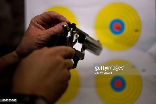 A man adjusts the sights on his 357 revolver at the Lynchburg Arms Indoor Shooting Range in Lynchburg Virginia on October 20 2017 Virginia residents...