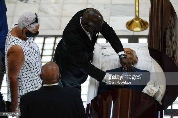 Man adjusts the tie of civil rights leader C.T. Vivian as he lies in state in the Georgia Capitol building on July 22, 2020 in Atlanta, Georgia. Rev....