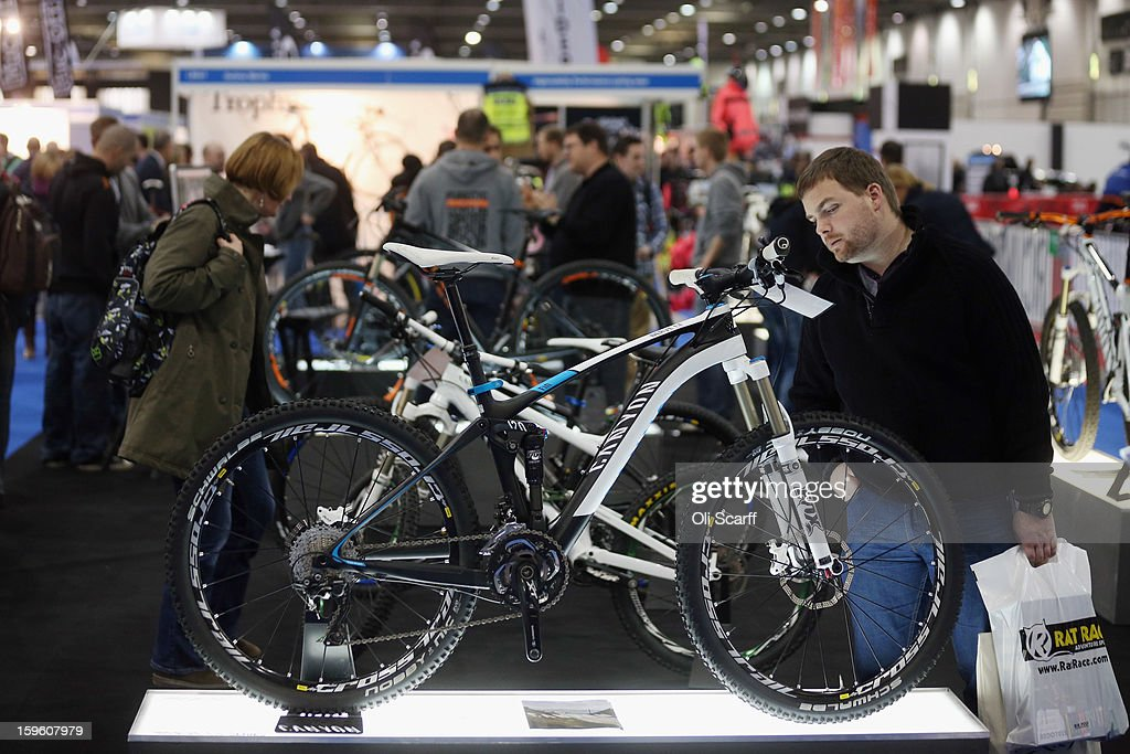 A man admires a Canyon mountain bike at the London Bike Show which is being held in the ExCeL Centre on January 17, 2013 in London, England. The ExCeL centre is hosting The Outdoors Show, the London Bike Show and the Active Travel Show which run until January 20, 2013 and features manufacturer trade stalls, speeches, demonstrations and areas where visitors can climb or ride bikes.