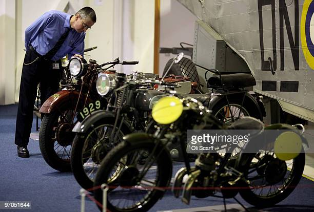 A man admires several of the motorbikes on display in the RAF Museum ahead of their sale by Bonhams auction house of 100 pre1950's motorcycles on...