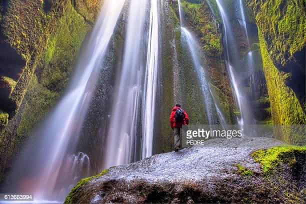 Man admiring Gljúfrafoss waterfall