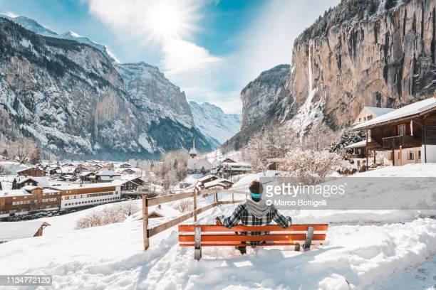 man admiring lauterbrunnen in winter, switzerland - bern canton stock pictures, royalty-free photos & images