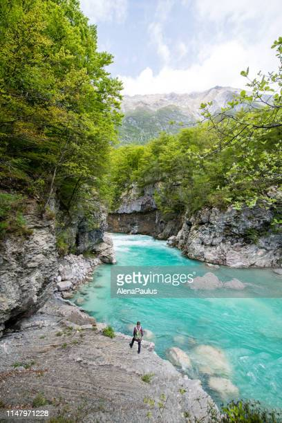 man admiring river soca canyon valley between kobard and bovec, julian alps, slovenia, europe - slovenia stock pictures, royalty-free photos & images