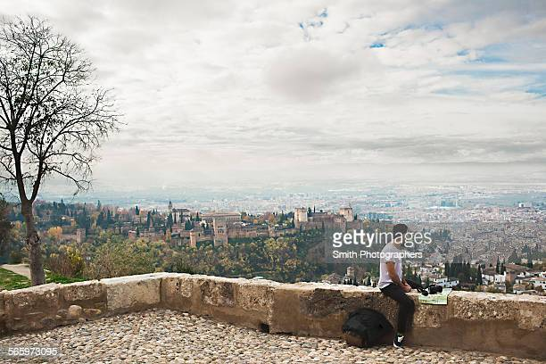 man admiring scenic view of cityscape, granada, spain - granada spain stock pictures, royalty-free photos & images