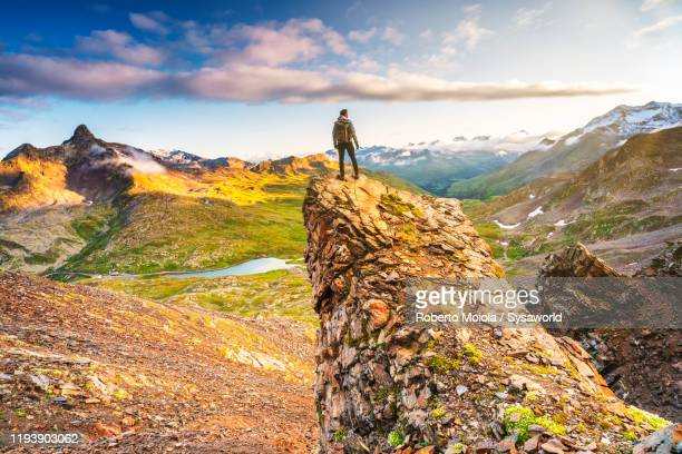 man admiring the alps standing on top of monte gaviola, valtellina, italy - mid distance stock pictures, royalty-free photos & images