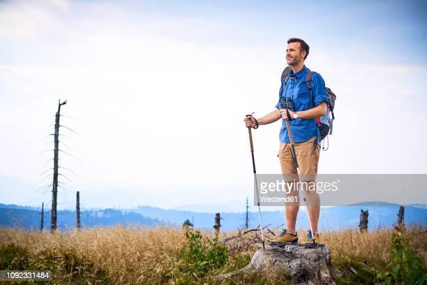 Man admiring the view during hiking trip