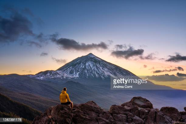 man admiring the view of volcano teide at dusk. tenerife, canary islands, spain - pico de teide stock pictures, royalty-free photos & images