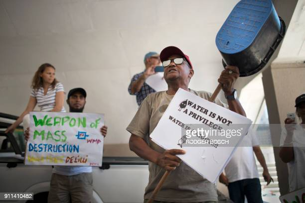 A man adresses hundreds of people taking part in a protest against the way the Cape Town city council has dealt with issues around water shortages on...