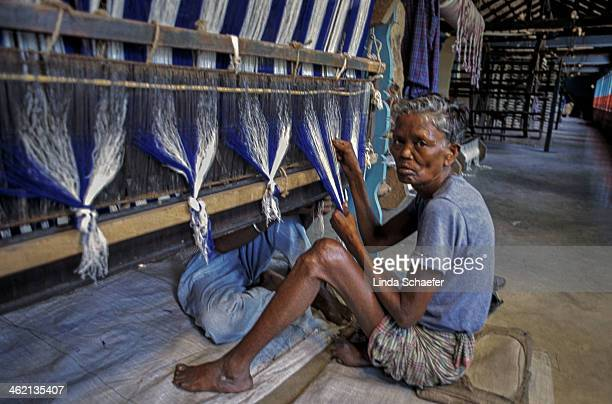 CONTENT] Man afflicted with leprosy weaves the saris that will be used by the sisters of the Missionaries of Charity the order Mother Teresa founded...
