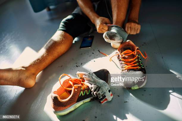 man after a workout - shoes stock pictures, royalty-free photos & images