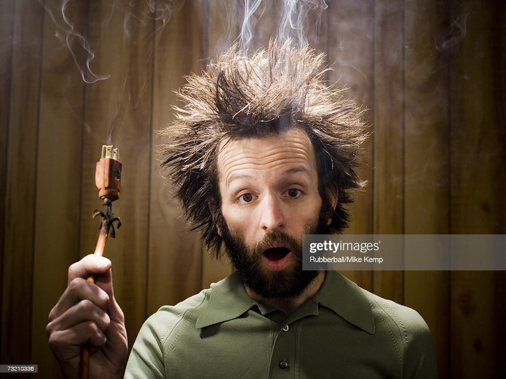 man after electric shock with electric plug and smoke stock photo getty images. Black Bedroom Furniture Sets. Home Design Ideas