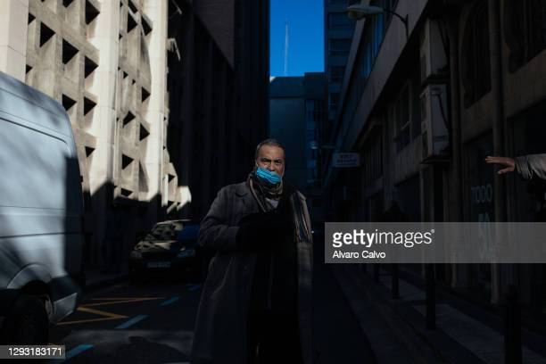 Man after picking up a tupperware with food from the soup kitchen of Carmen parish on Christmas Day, due to the restrictions of the pandemic, the...