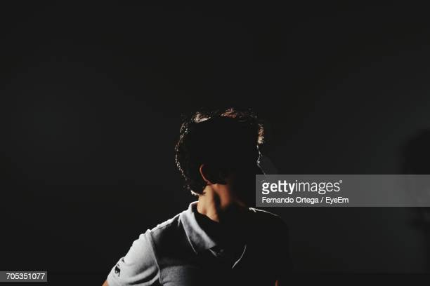 man against black background - back lit stock pictures, royalty-free photos & images