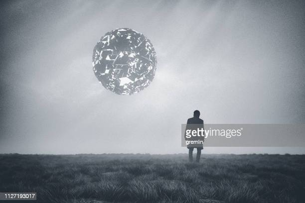 man against mysterious alien ufo - military invasion stock pictures, royalty-free photos & images