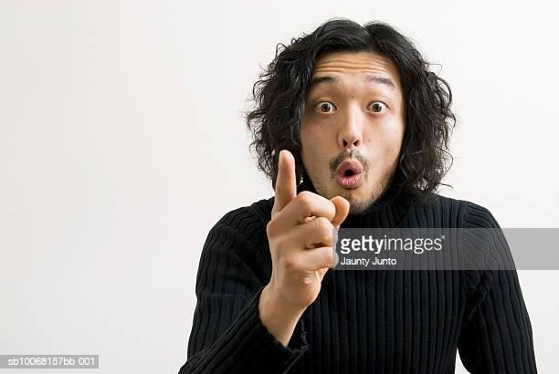 Man against white background, portrait, close-up