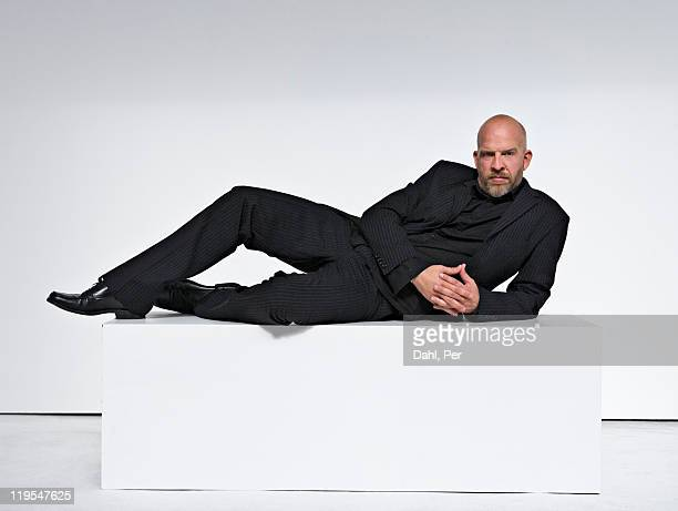 man against white background, portrait - lying down foto e immagini stock