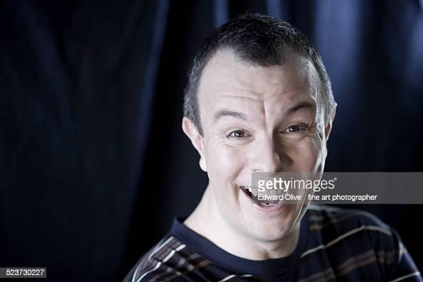 man aged 35-45 laughing loudly, studio shot - komiker stock-fotos und bilder