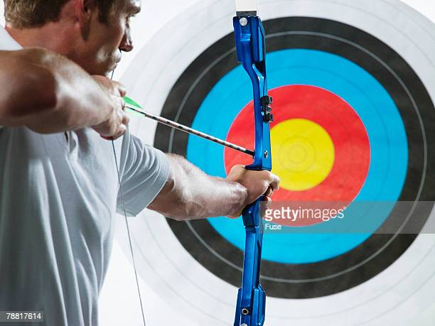Man Aiming a Bow