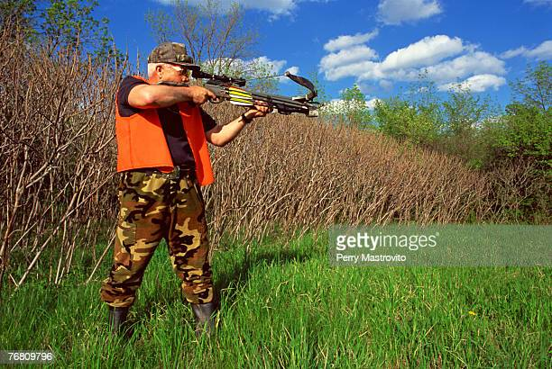 Man aiming a crossbow