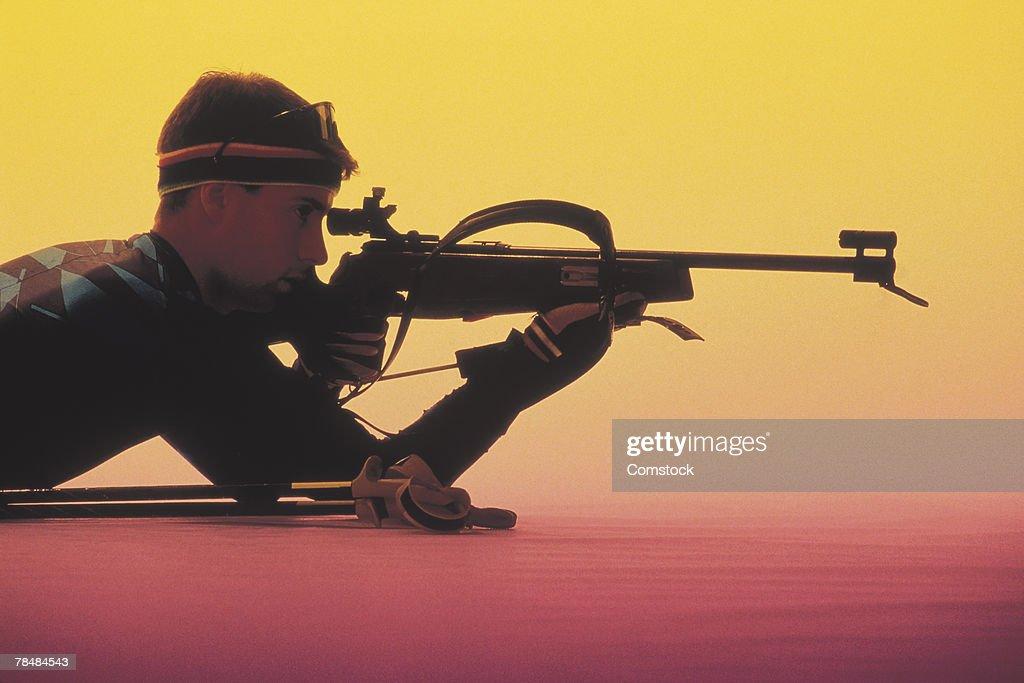 Man aiming a rifle : Stock Photo