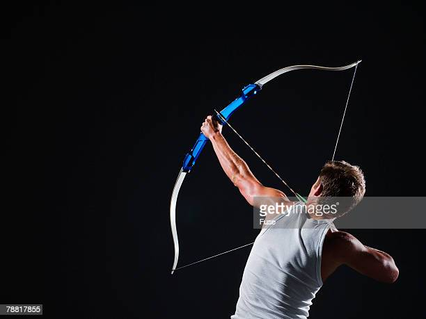 Man Aiming an Arrow