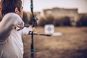 Man aiming at target