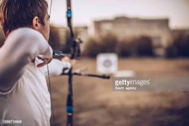 man aiming at target - aiming stock pictures, royalty-free photos & images