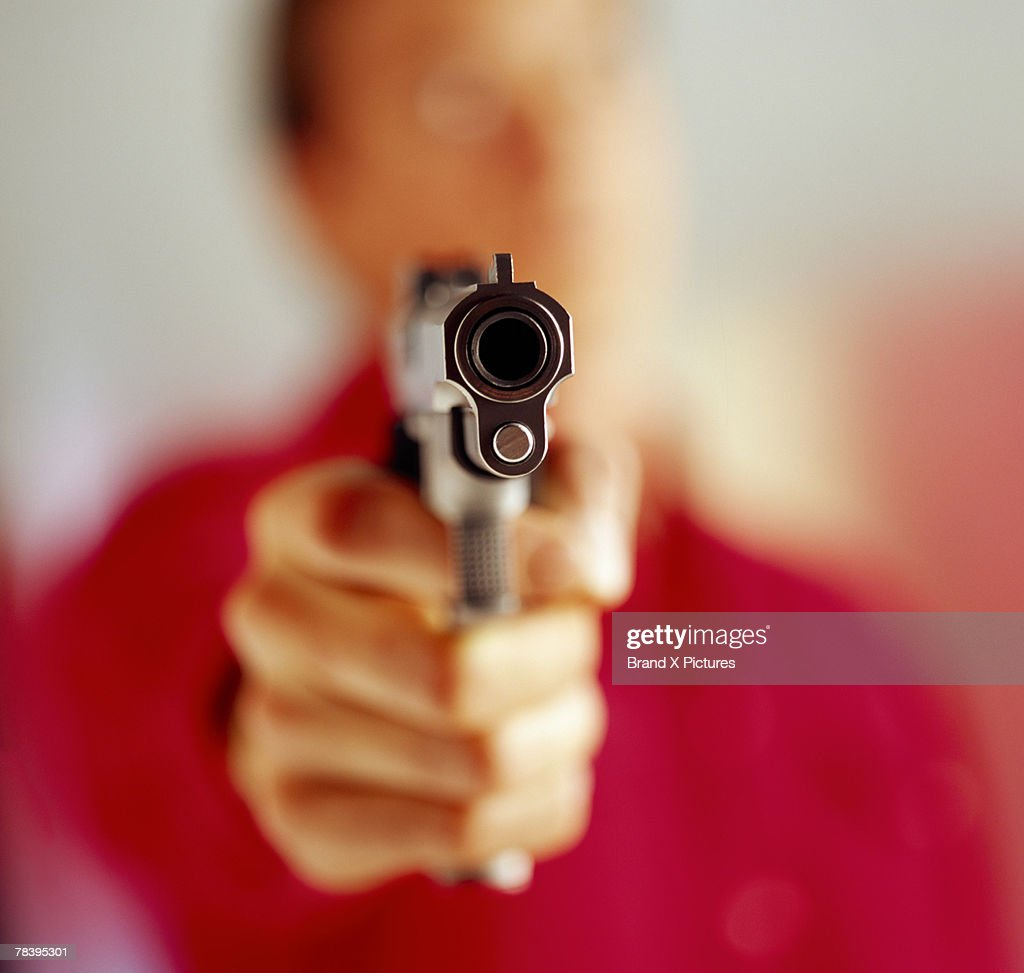 Man aiming gun : Stock Photo
