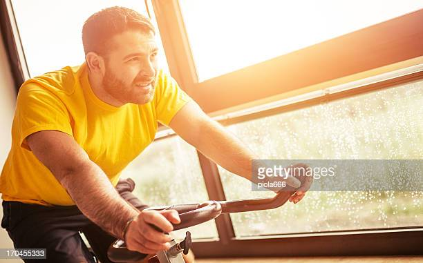 Man Alone Spinning at Gym