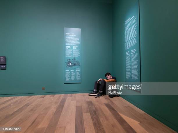 A man alone sitting in the corner of a room of the Orsay Museum in Paris France the 8 december 2019