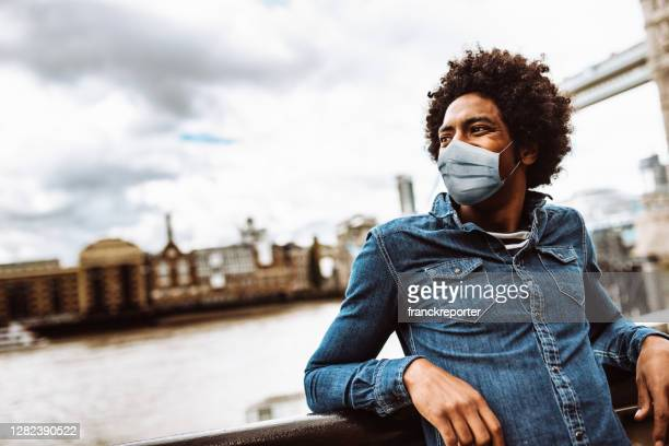 man alone with face mask in london - epidemiology stock pictures, royalty-free photos & images