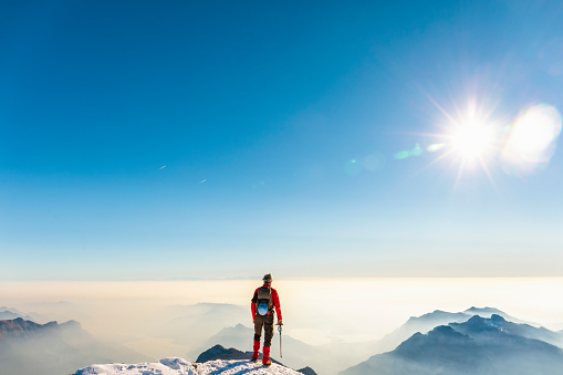 Man alpinist on top of the mountain - gettyimageskorea