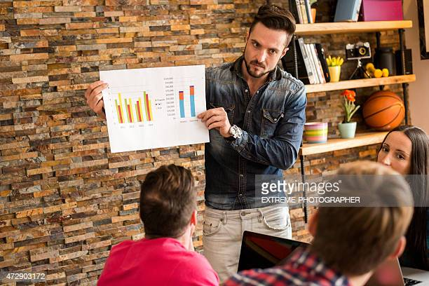 Man analyzing data chart in the office