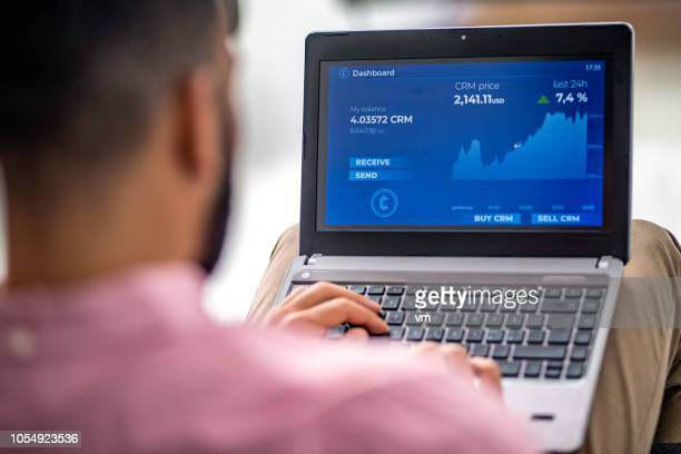 man analyzing financial chart on his laptop - computer monitor stock pictures, royalty-free photos & images