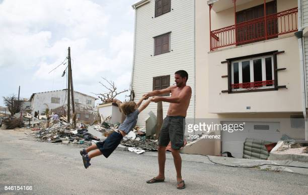 A man and a boy play in Grande Case Saint Martin days after this Caribbean island sustained extensive damage after the passing of Hurricane Irma on...
