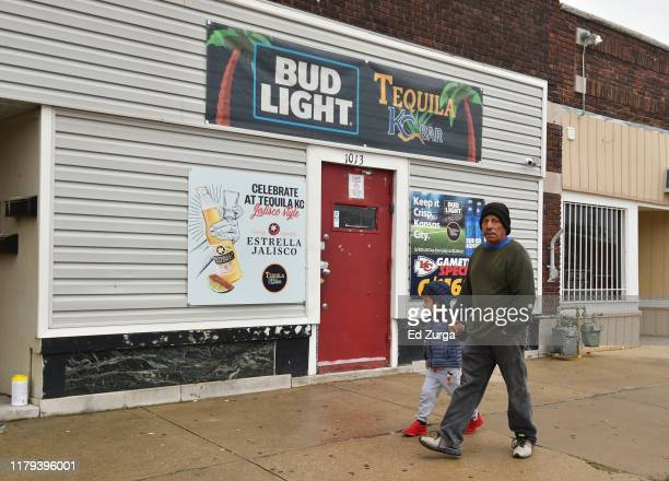 A man and a boy walk past the entrance to Tequila KC bar were 9 people were shot and four killed on October 06 2019 in Kansas City Kansas According...