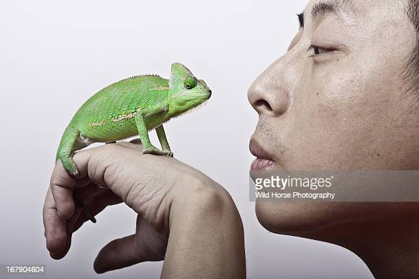 A man and a chameleon face-to-face