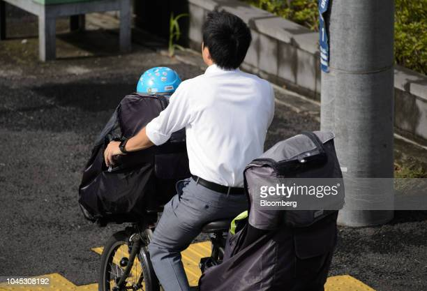 A man and a child ride on a bicycle in Kawasaki Kanagawa Prefecture Japan on Tuesday Sept 18 2018 Japan's population of 127 million isforecast to...