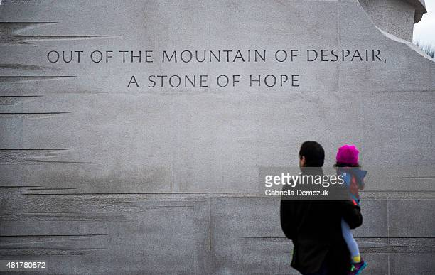 A man and a child stand near the Martin Luther King Jr Memorial on the National Mall on MLK Day January 19 2015 in Washington DC Martin Luther King...